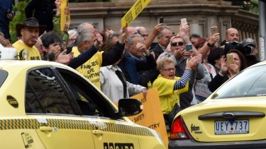Taxi owners protesting at Parliament House on Monday.