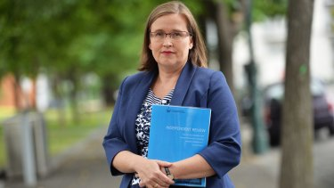 Victorian Equal Opportunity and Human Rights Commissioner Kate Jenkins with a copy of the review of sexual harassment in the police force.