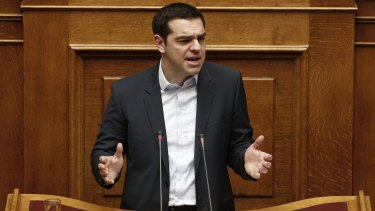 Greek Prime Minister Alexis Tsipras delivers his speech in parliament.