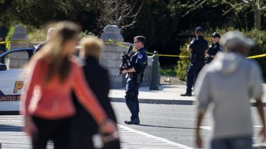Capitol police officers on patrol after shots were fired at the visitor's centre of the Capitol in Washington on Monday.