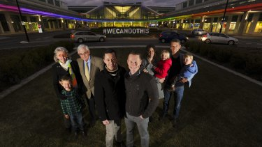 Tom Snow and husband Brooke Horne with members of the Snow family, who are supporters of gay marriage and have lit the terminal in support of the cause.