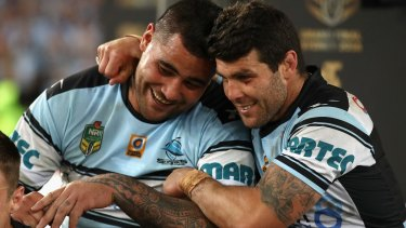 Offer: Andrew Fifita celebrates premiership success with Michael Ennis.