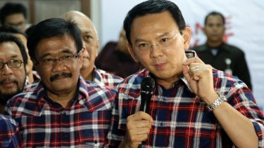 Under pressure: Ahok, right, with his gubernatorial running mate Djarot Saiful Hidayat, a Muslim, in Jakarta last month.