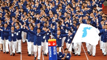 Athletes from North and South Korea march together, led by a unification flag during opening ceremonies for the 14th Asian Games in Busan, South Korea, in 2002.
