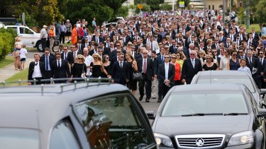 The funeral procession through the streets of Macksville.