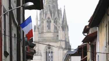 A French flag hangs from a balcony in Bayonne, south-western France, on Thursday.