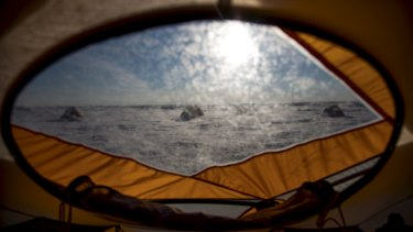 The view from a tent at a researchers' camp near a supraglacial lake and river on the Greenland ice sheet in July.