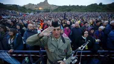 A bagpiper from the Australian army salutes during the dawn ceremony at Anzac Cove on Saturday.