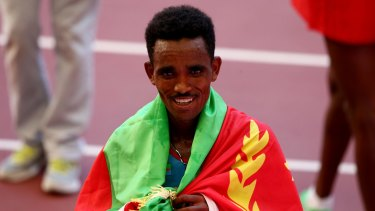 Ghirmay Ghebreslassie of Eritrea celebrates after crossing the line to win gold in the Men's Marathon in the World Athletics Championships in Beijing in August. Sport has been a path that many elite Eritrean athletes have used to seek asylum outside their country.