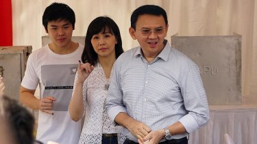 Jakarta Governor Basuki Tjahaja Purnama, known as Ahok, right,  with his wife Veronica and son Nicholas at a polling station in Jakarta.