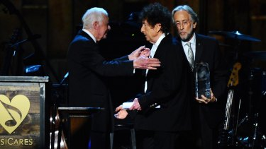 Jimmy Carter presents Bob Dylan with the award for the 2015 MusiCares Person of the Year.