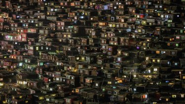 The surreal Larung Gar encampment at night. The coloured glass or plastic windows of the huts make for an impressive sight as night falls.