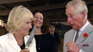 Britain's Prince Charles jokes with his wife Camilla, Duchess of Cornwall during a visit to Seppeltsfield Winery in the Barossa Valley.