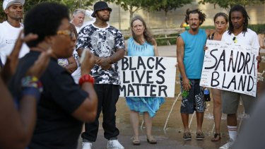 Activists and community members gather for a prayer vigil and march in memory of Sandra Bland.