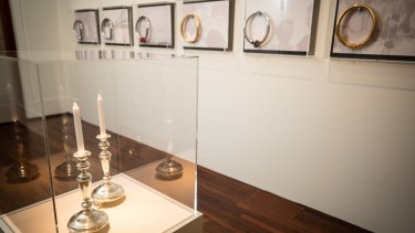 A pair of Shabbat candlesticks and a series of necklaces feature in work by Lousje Skala as part of The Gift, an exhibition about migration at the Museum of Australian Democracy at Old Parliament House in Canberra.