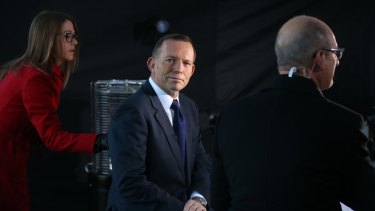Prime Minister Tony Abbott sells the budget outside Parliament House in Canberra.