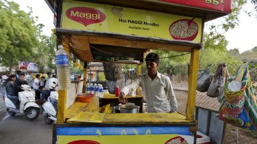 A vendor works at a roadside Maggi noodles eatery in Ahmedabad, India.