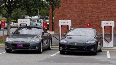 Full charge ahead: Tesla cars power up at a charging station.