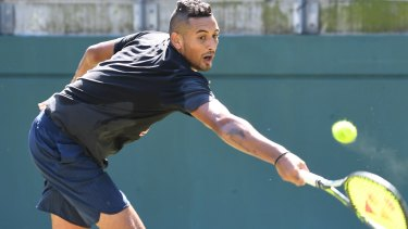 Limbering up: Nick Kyrgios practises on Monday ahead of Australia's David Cup play-off against Slovakia.