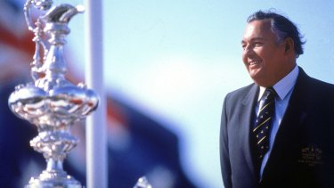 Alan Bond with the America's Cup sailing trophy in 1993.