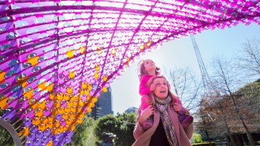 The Age, News . The NGV release its new Garden Sculpture, a nine metre high pink pavilion.The first visitors Lexi and mum Julie Wise in the foreground.Pic Simon schluter 23 September 2015.