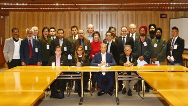 Vic Alhadeff, seated centre, has spearheaded calls for hate speech law reform.