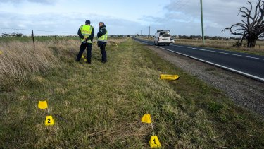 Police inspect the scene of the fatal hit and run at Anakie on Monday.