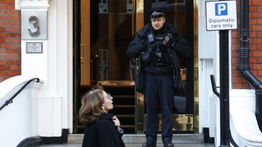 A police officer guards the Ecuador embassy in London.