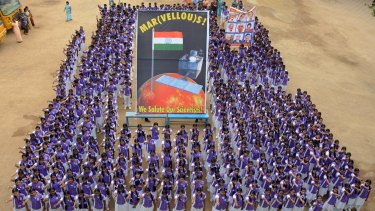 Indian school children stand in formation as they celebrate the success of India's Mars Orbiter Mission, at a school in Chennai