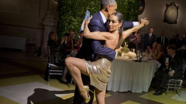 President Barack Obama does the tango with a dancer during the state dinner in Buenos Aires, Argentina on Wednesday.