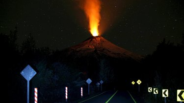 Smoke and lava spew from the Villarrica volcano in March.