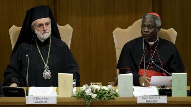 Cardinal Peter Turkson (right) and Eastern Orthodox metropolitan of Pergamon John Zizioulas attend a news conference for the presentation of Pope Francis' new encyclical titled 'Laudato Si (Be Praised), On the Care of Our Common Home', at the Vatican.