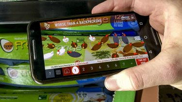 Choice's Cluck AR app in action at a Woolworths store.