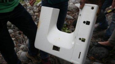 The plastic piece of debris.