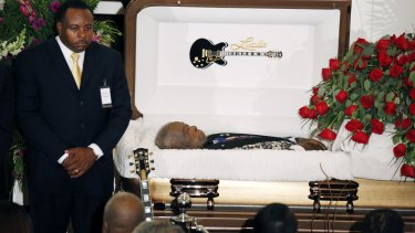 A funeral home attendant stands watch over the casket bearing blues legend BB King prior to his funeral mass at Bell Grove Missionary Baptist Church in Indianola.