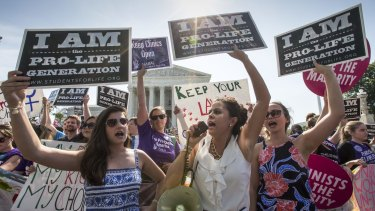 Anti-abortion activists demonstrate in front of the Supreme Court as the justices struck down the Texas law.