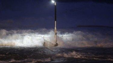 Huge waves crash over swimming baths at Avalon Beach.