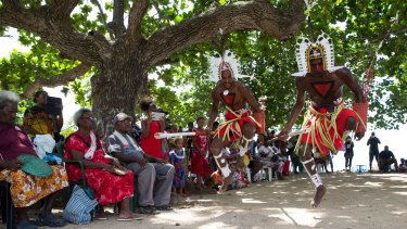 Locals watch the Neguams Dance Troup perform for the Recognise team on Mer Island in the Torres Strait. The team has spent two weeks traveling between islands promoting the campaign to gain recognition for Aboriginal and Torres Strait Islanders in the Australian Constitution.