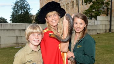 Terri Irwin with son Robert and daughter Bindi after receiving her honorary degree from the University of Queensland.