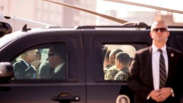 Donald Trump, left, greets members of the military as he arrives at Camp Humphreys in Pyeongtaek, South Korea.