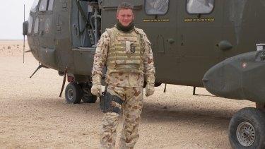 Veteran: Aaron Gray rode shotgun on top of an ASLAV in Iraq.