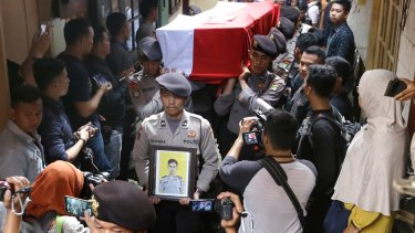 Police officers carry the coffin of their colleague Sergeant Gilang Imam Adinata who was killed in Wednesday's  bombings in Jakarta.