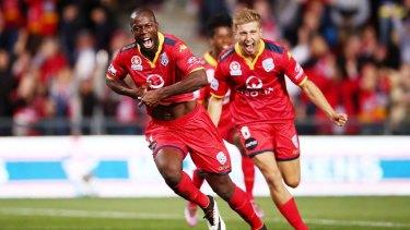 Bruce Djite of Adelaide celebrates after scoring against Melbourne City.