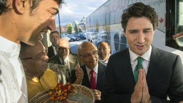 Liberal leader Justin Trudeau shows a traditional Hindu greeting during a Hindu welcoming ceremony in Markham, Ontario.