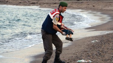 A paramilitary police officer carries the lifeless body of Alan Kurdi. The infant's death sparked an outpouring of goodwill in Australia and beyond.