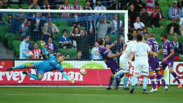 Connor Chapman of Melbourne City scores with a header past Perth Glory goalkeeper Ante Covic.