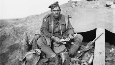 "Private John ""Barney"" Hines, A Company, 45th Battalion, with his trophies (souvenirs) obtained on the morning of the advance of the 4th and 13th Brigades at Polygon Wood."