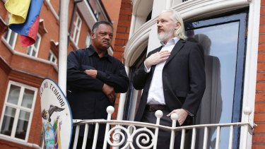 Julian Assange with Reverend Jesse Jackson on the balcony of the Ecuadorian embassy in 2015.