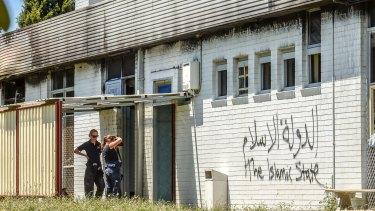 Police at the Iman Ali Islamic Centre in Fawkner in December.