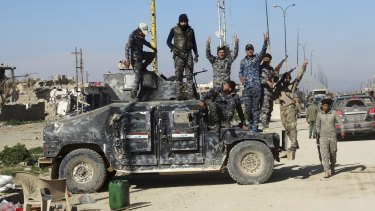 Iraqi security forces celebrate after regaining control of the town of Husaybah, 8 kilometres east of Ramadi, Iraq, after heavy clashes with Islamic State fighters.